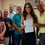 Nova filiada em Juiz de Fora, ao lado do coordenador regional Olavo Antônio de Oliveira e do diretor de base Alexandre Magnus.